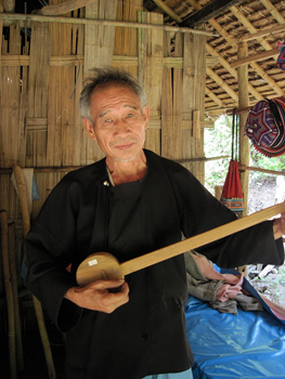 This Lisu Hill Tribesman charmed me with a song on his homemade instrument.