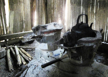 The kitchen area inside of a typical Lisu Hill Tribe home