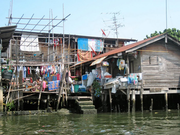 Laundry flaps in the wind at this shack on the canal in Bangkok.