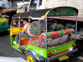 A tuk-tuk waits in a traffic jam in Bangkok.