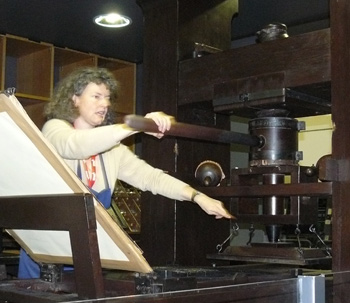 Tour guide Judith König conducts a demonstration at the Gutenberg Museum in Mainz.