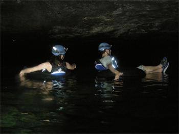 Floating deep inside Crystal Cave, Belize.