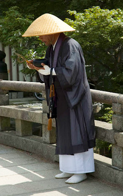 A monk offers blessings to visitors, Toda-ji Temple, Nara, Japan