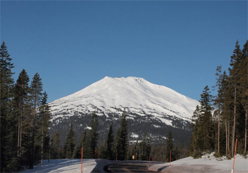 Mount Bachelor shows its snowy dome, with skiing around the entire perimeter of the big former volcano.