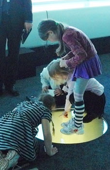 Children look down to the ground 558 feet below the observation deck of the Talinn TV Tower.
