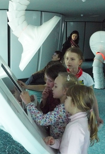 Kids play with interactive exhibits at the Tallinn TV Tower in Estonia