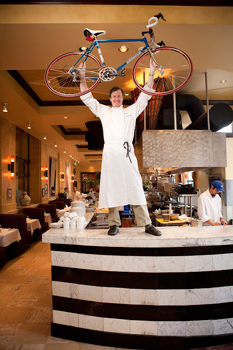 Bambara Bistro chef shows off his prized bicycle. photos by Sonja Stark.