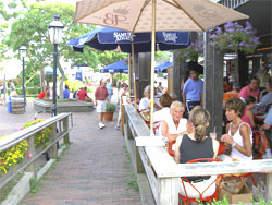 Enjoying cocktails at the Tavern, on Straight Wharf, Nantucket.