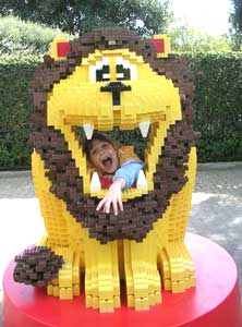 Isabella is swallowed by a Lego lion.