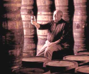 """James C. """"Jimmy"""" Russell, master distiller at the Wild Turkey Distillery in Lawrenceburg, reviews a sample."""