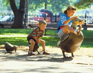 Kids play on the statues in the Boston Public Gardens inpired by Robert McCloskey's children's book, 'Make Way for Ducklings'