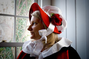 This roving caroler made her own hat and floor-length cape in Dickens-era fashion.