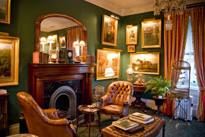 A sitting room of the Charlotte Inn casts its warmth, even when the fireplace has not yet been lighted for the day.