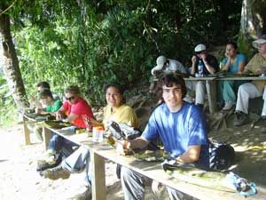 Peder and Lucy having lunch by the Amazon lake