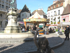 At the fountain that kids love at the Place Francois Rude.