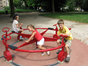 On the Dijon park playground, doing what kids love to do.