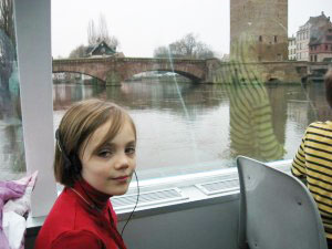 Listening to the children's audio guide on a boat ride of the Ill river.