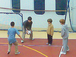 Justin and friends playing soccer aboard ship