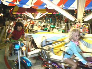 Kids enjoy riding around and around in Casino Pier in Seaside Heights. photos by Max Hartshorne.
