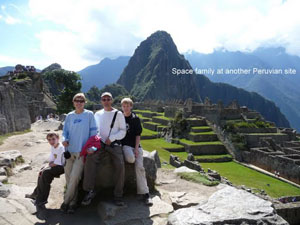 Space family at the top of Machu Picchu