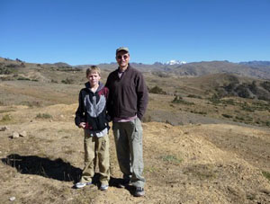 The author and his son at the top of the Andes