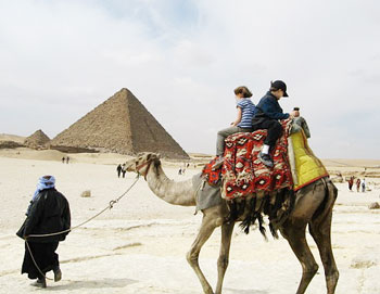 Riding a camel around the Pyramids and the Sphinx. Photo by Alexandra Regan