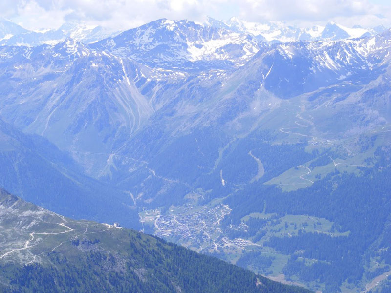 View of the village of Grimentz from the summit of Bella Tolla in Val D'Hanniviers, Switzerland. Photo by Steven Bochenek.