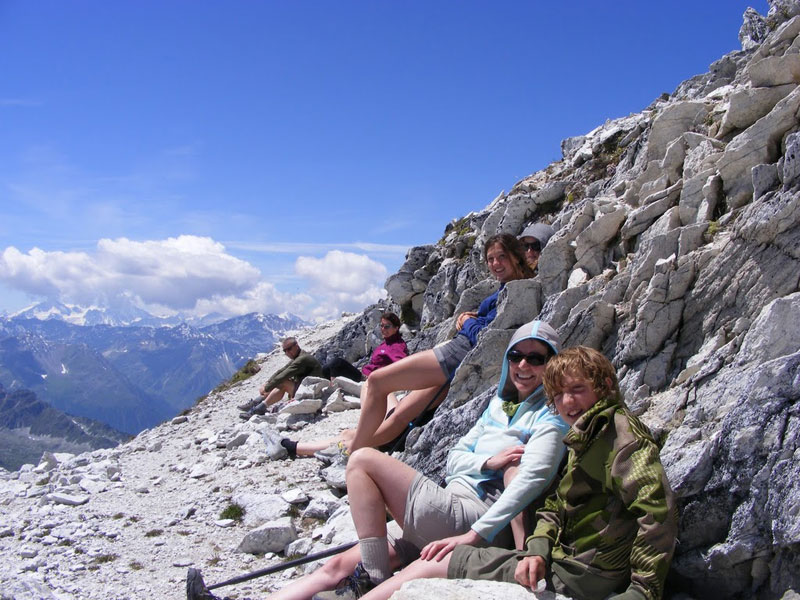 A warm lea, protected from the winds rushing up the other side and just two meters beneath the peak, was at least ten degrees centigrade warmer than the top. We sat here and dozed for a quarter hour, basking in a victorious feeling. Bella Tolla in Val D'Hanniviers, Switzerland