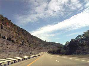 This photo shows typical roadcut landscape with coal seams along the Country Music Highway. Photo courtesy of Byways.org © 2001. SEKTDA.