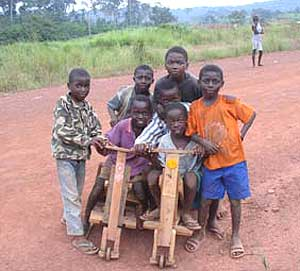A group of kids on the Congo side of the border with their home-made scooters. Photos by Will Sparks