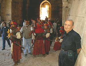 The author is shown with actors inside the Crac des Chevaliers.