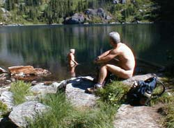 Relaxing by the lake in the buff on a nude hike.
