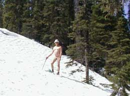 Dick Mason on the rock slide. Being naked in the mountains is a thrill for many hikers.
