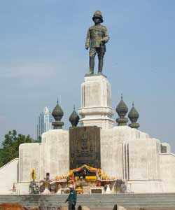 King Rama VI stands sentinel above his memorial. Rama VI ruled Thailand from 1911 - to his death in 1925. In 1925 he donated this land to be used as a public park and fairground.