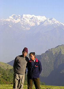 The auithor and her husband are shown with the Himalayas in the background. Photos by Mridula Dwivedi
