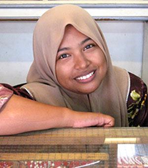 Shopgirl in Malacca, Malaysia. photo by Liz Chow.