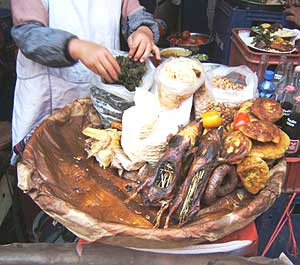 Seaweed, roe, fresh cheese, and cuy stuffed with spices make up the meal for Cuzco's Festival of the Virgin in early September. Utensils are for wimps, and aren't offered anyway.