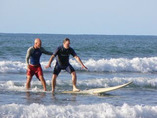 Max Hartshorne surfing with Greg Page