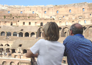 Contemporary spectators view the ruins of the Colosseum in Rome where emperors once enjoyed bloody spectacles of combat and slaughter.