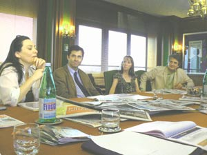 Journalists talk about the issues of concern in Bologna at a newspaper office.