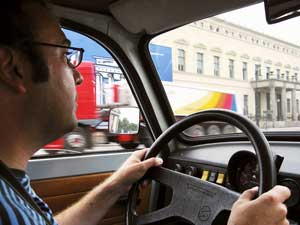 The author drives a 1987 Trabant along the streets of East Berlin as part of the Trabant Safari.