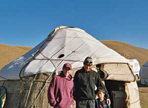 The author, his guide, and a shepherd boy at their yurt on the second day of the hike in the plains of Krygyzstan.
