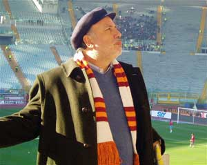 A fan arriving for an AS Roma game in Rome.