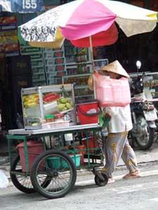 A street vendor in Ho Chi Minh City, still known as Saigon