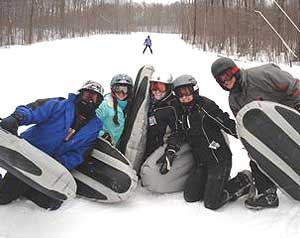 A family group enjoys airboarding at 'Smuggs' or Smugglers' Notch Photos by Sony Stark