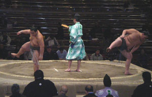 Spectators start to arrive as the middle-ranked sumo wrestlers meet in Japan.