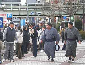 Junior sumo wrestlers arrive for their morning fights.