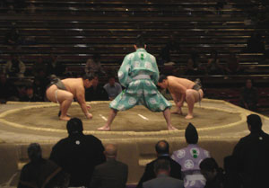 The gyoji (referee) prepares for the start of another sumo wrestling bout.