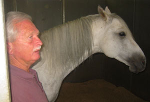 Dave Rhea with one of his Arabian horses on Mandolynn Farm in North Texas