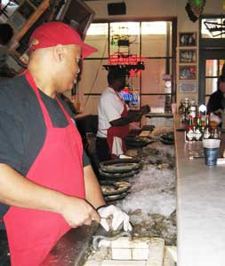 Oyster shuckers at work at the Acme Oyster House in New Orleans